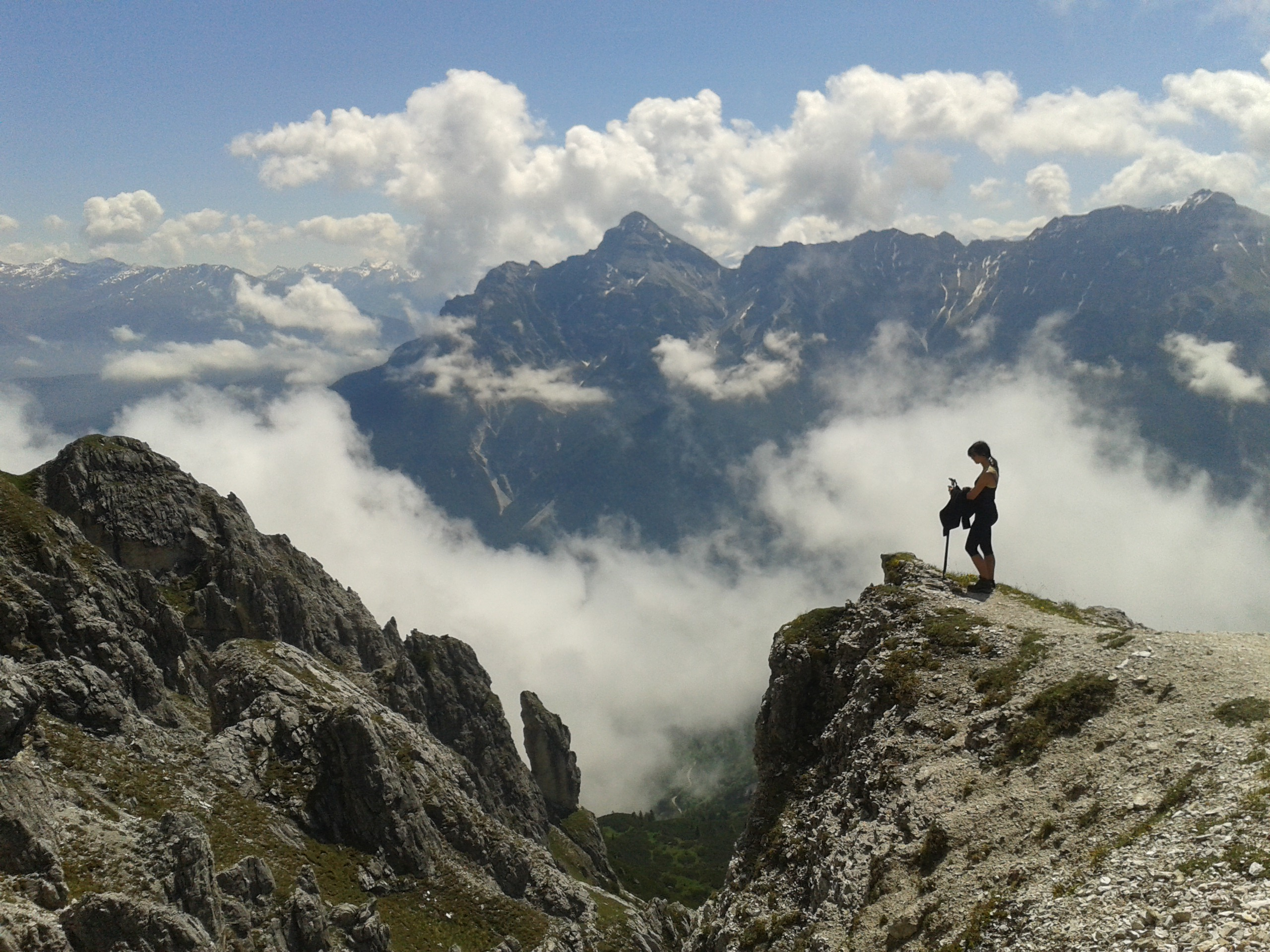 Hiking in Stubaital in Austrian Alps. A walk over the clouds.